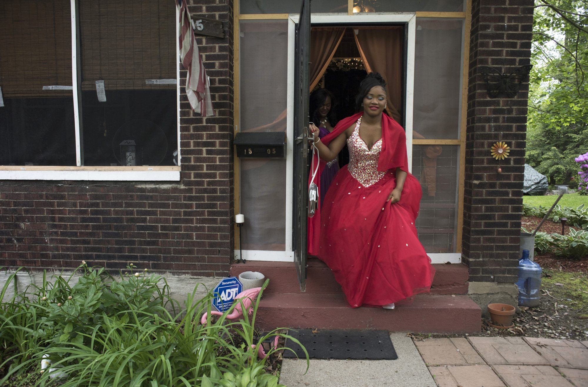 Tyneisha Wilder leaves her foster home in Wilkinsburg for East Allegheny High School's Promenade. Promenade is a high school tradition when the couples line up and are presented before an audience of family, friends and community members. (Photo by Martha Rial/PublicSource)